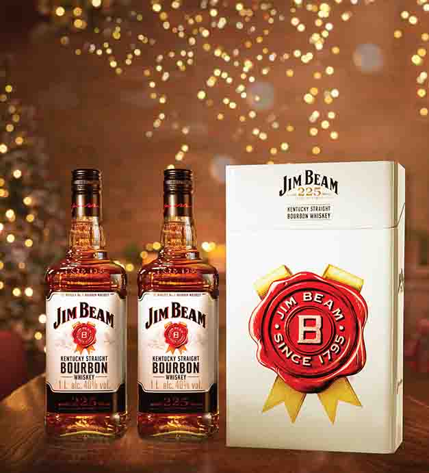 The limited-edition Jim Beam tin can be used as an ice-bucket and garnish tray for your homemade holiday highballs